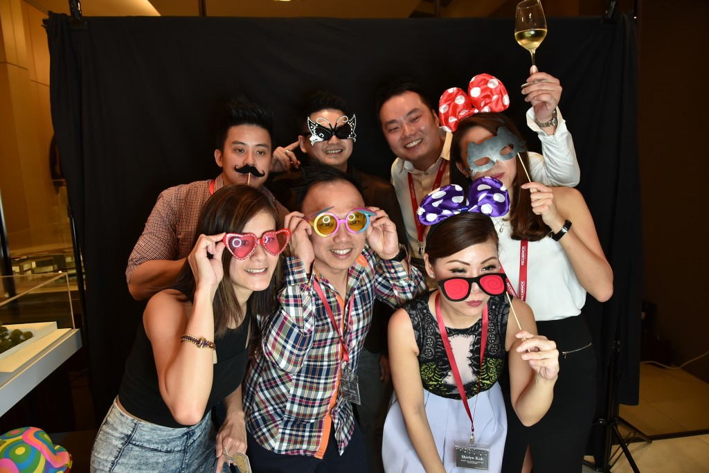 Guests coming together for a shot at the GIF photo booth.